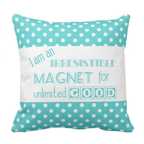"Colorful, positive affirmation throw pillow. Aqua typography against an aqua and white polka dot background featuring the affirmation ""I am an irresistible magnet for unlimited Good."""