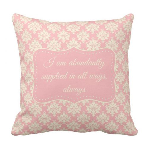 "Cream-colored typography against an elegant pink and cream damask background featuring the affirmation ""I am abundantly supplied in all ways, always."""