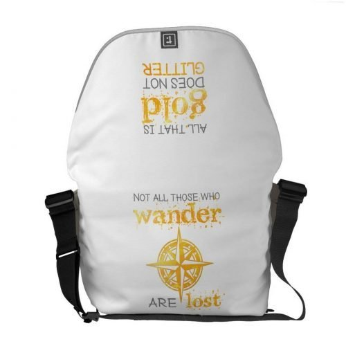 "messenger bag with the inspirational quote ""All that is gold does not glitter. Not all those who wander are lost"" in gogld and dark gray typography"