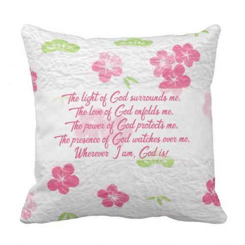 Prayer for Protection pillow. Pink typography against an elegant pink and green floral background featuring the following Prayer for Protection: 'The light of God surrounds me. The love of God enfolds me. The power of God protects me. The presence of God watches over me. Wherever I am, God is!'